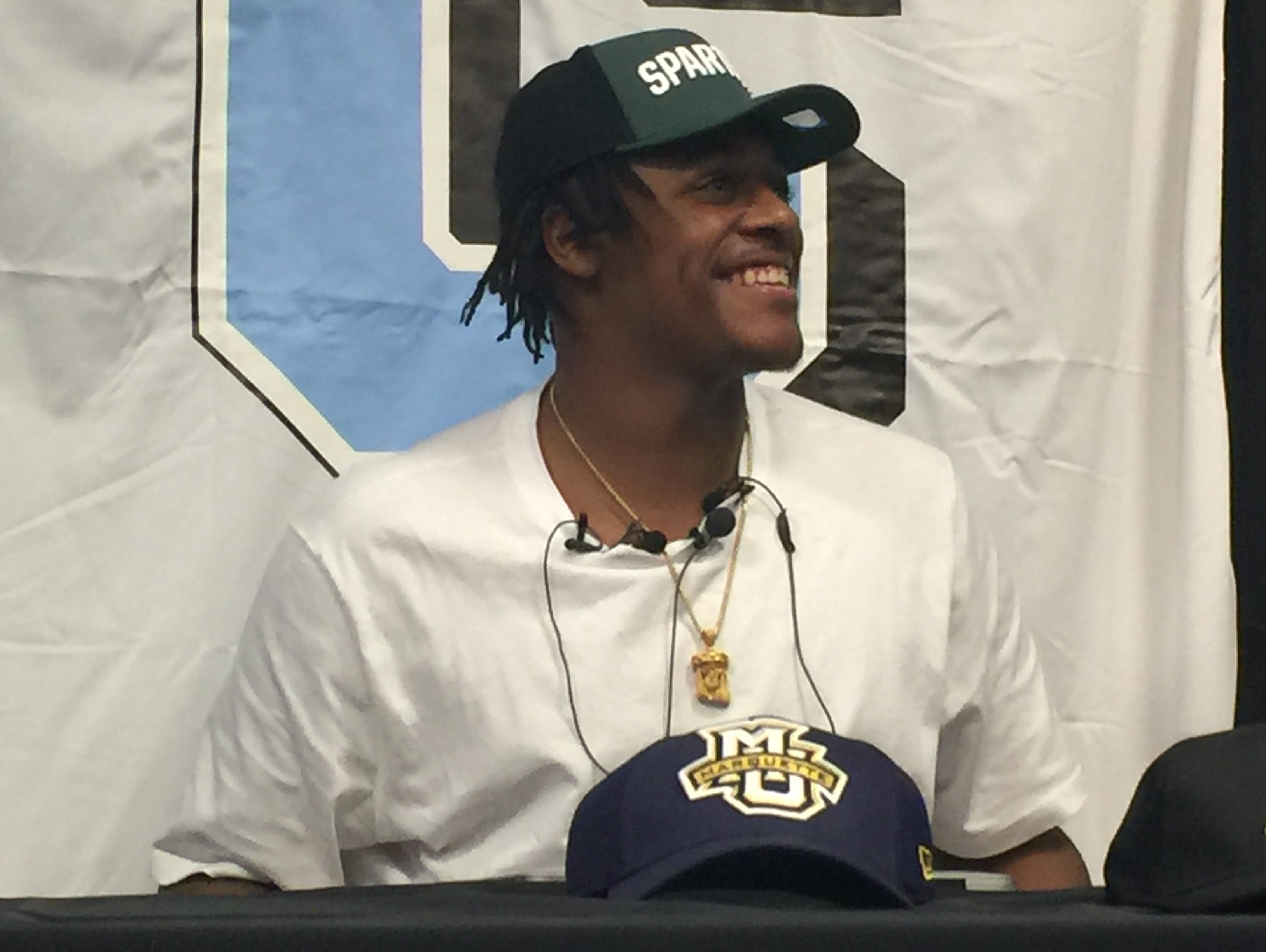 Grand Rapids Christian power forward/center Xavier Tillman wears an MSU hat after committing to the Spartans on Sept. 30, 2016.