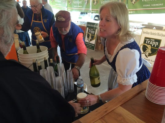 Jennifer Campbell of Waterbury Center dispenses beer in 2016 at the Stowe Oktoberfest.