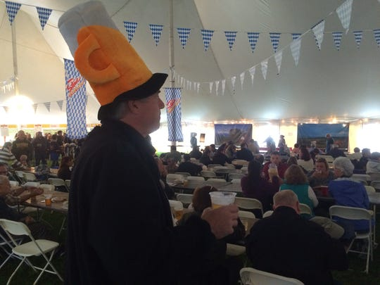 Karl Behrend watches the Inseldudler German Band in 2016 at the Stowe Oktoberfest.
