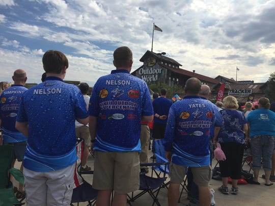 Bass fishing fans pause for the National Anthem prior to Saturday's Bassmaster Central Open weigh-in.
