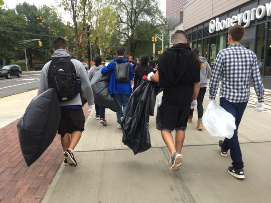 Rutgers students cleaning up litter in New Brunswick on Saturday for the 10th annual Scarlet Day of Service.