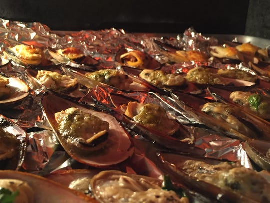 After three minutes under the broiler, the mussels are merrily sizzling away and almost ready to go.