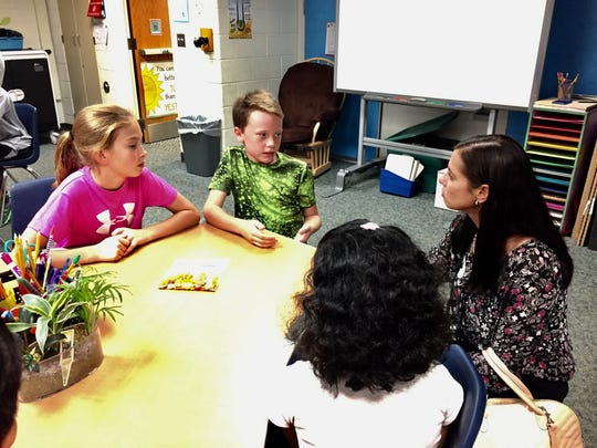 Algonac Jr. High teacher Jamie Smith talks with Novi Wood Elementary School students about what kind of furniture they like to use on Tuesday, Oct. 4, 2016.