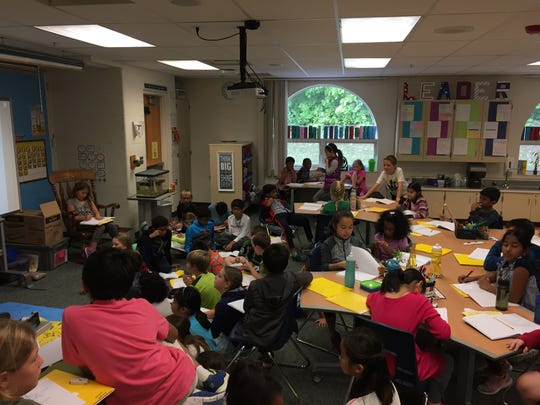 Fourth grade students in Novi Woods Elementary use alternative seating options during a lesson on Tuesday, Oct. 4, 2016. Their classroom is an example of a 21st century classroom.