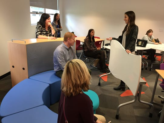 St. Clair County teachers who have received the Classroom 4 the Future look at different furniture options at TMP Architecture on Tuesday, Oct. 4, 2016.