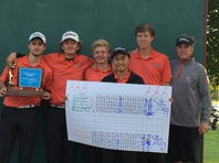 The Central York golf team poses with the District 3 championship trophy and scorecard after winning the Class 3A team championship Tuesday at Briarwood Golf Club. Pictured from left are Matt Bricker, Will Gekas, Carson Bacha, Julianne Lee, Joe Parrini and coach Sean Guerin.
