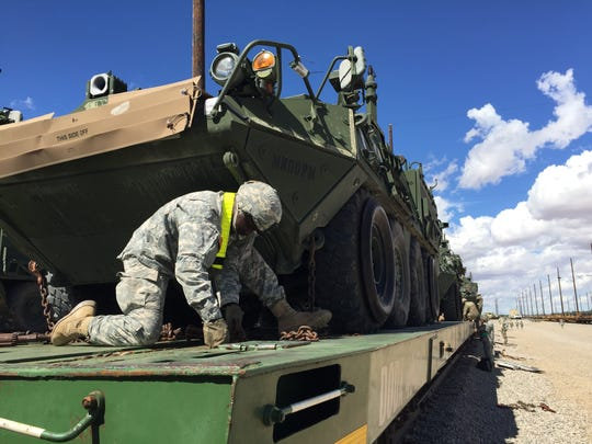 Soldiers from 1st Brigade are loading vehicles and then tying them down before shipping them to Fort Irwin, Calif., for an upcoming rotation at the National Training Center.