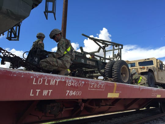 Loading vehicles and equipment onto rail cars mark the unofficial beginning of 1st Brigade's training rotation at the National Training Center at Fort Irwin, Calif.