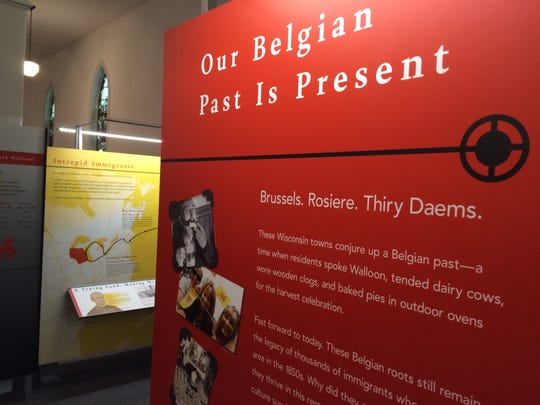 The museum-style panels of the historical exhibits at the Belgian Heritage Center utilize the colors of the flag of Belgium.
