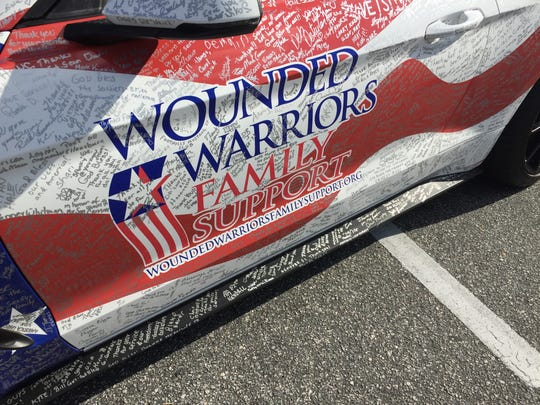 The Wounded Warriors Family Support's High Five Tour Mustang was on display at Fountain Inn City Hall Wednesday. The car has received signatures throughout the country to raise funds for programs that help combat veterans.
