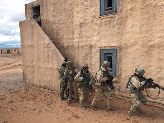 Soldiers from 1st Brigade recently went through the Iron Focus exercise at Fort Bliss. Here, soldiers go house to house during an urban assault exercise.
