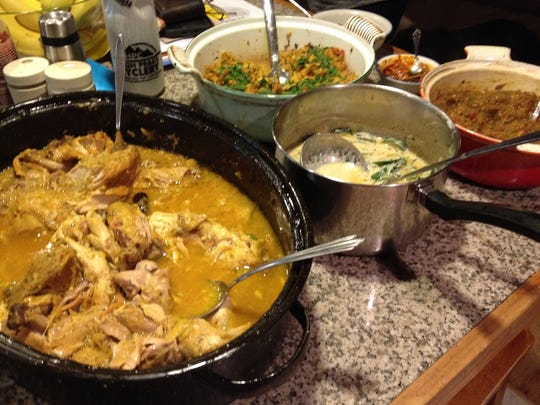 A big stew pot of cardamom chicken (left) kicks off