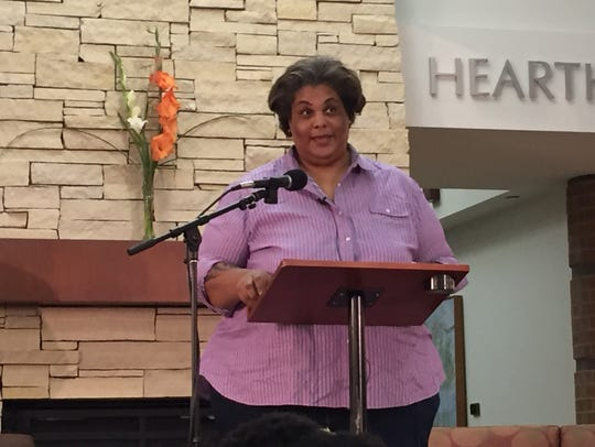 Writer Roxane Gay speaks in front of a crowd at the