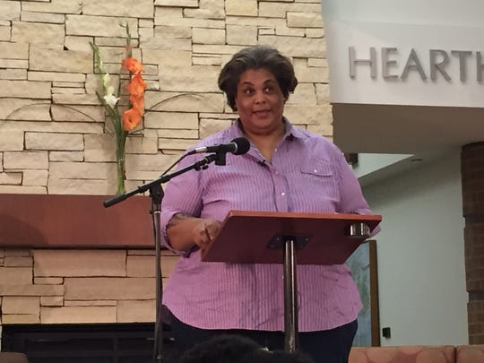 Writer Roxane Gay speaks in front of a crowd at the Coralville Public Library on Aug. 6, 2016. Gay was accepting the Paul Engle Prize as part of the Iowa City Book Festival.
