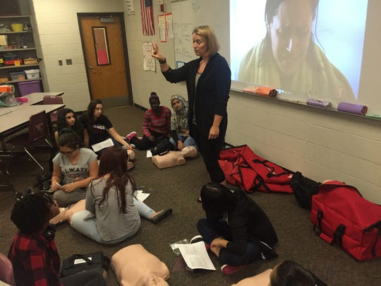 Health teacher Katie Gabrielli gives instructions to