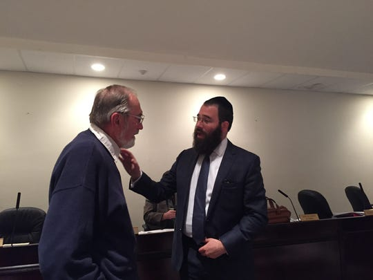 Rabbi Laibel Schapiro, right, director of Chabad of the Shore, talks with Long Branch Planning Board member Richard Honymar, during a break in a public hearing on Oct. 5, 2016.