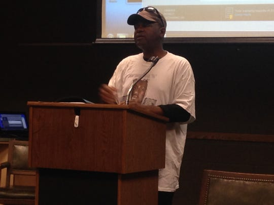 L'Sana DJahspora, father of the late Cinque DJahspora, speaks Thursday at a social justice forum at the Jackson-Madison County Library.