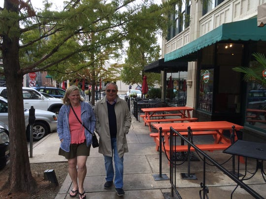 Charleston, South Carolina residents Cathy and James Law came to Asheville for an impromptu vacation after having to evacuate. On Friday morning, they strolled around the Grove Arcade.