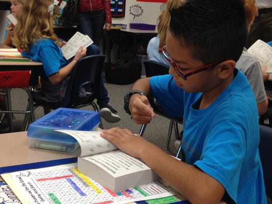 Rotarians give dictionaries to third graders in Lee