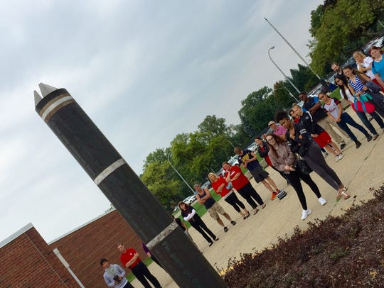 Students and staff gathered recently to rededicate