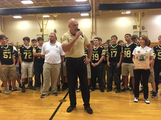 Athletic Director Steve Nolen tell players and coaches