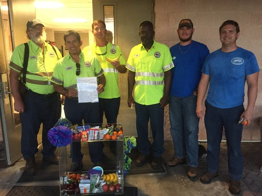 """City of Naples employees show off """"food cart Friday,"""" part of the city's Blue Zones project"""