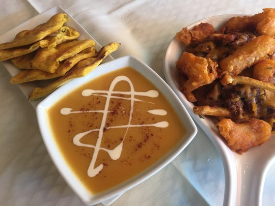Indeblue's innovative fare includes (clockwise from left) pumpkin naan, a special Indian lamb take on poutine, and pumpkin soup.