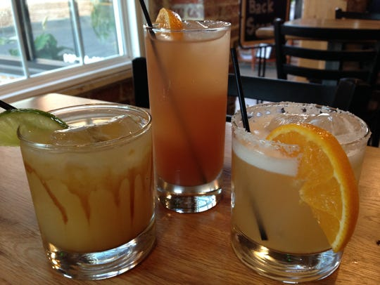 Mason Dixon Distillery rum cocktails, from left, the