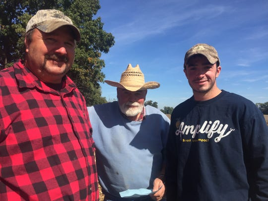 Joshua Hoffman, left, Wayne Hoffman, center, and Weston Hoffman, right stand at the family farm. Wayne Hoffman started the farm in 1969 after serving in the U.S. Army.