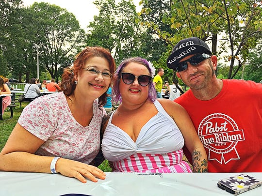 ParksFest Michelle Williams and Steve Hendrix help Laura Weibush (center) celebrate her birthday at the 3rd Annual ParksFest, a free music festival dedicated to bringing awareness to Evansville city parks, held at Garvin Park.