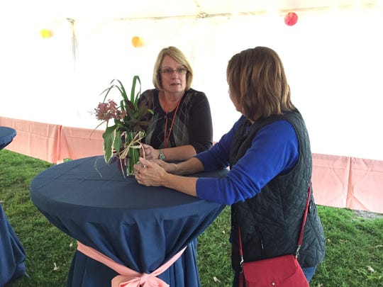 Sue Hawley, left, and Martha Serafin chat during the Port Huron Museum's Hoptoberfest fundraiser.