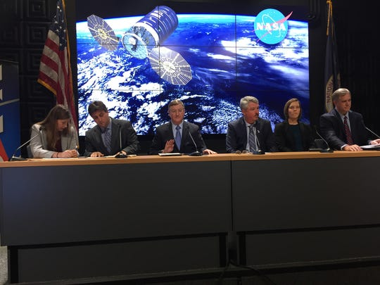 Officials, including Frank Culbertson, Orbital ATK's space systems group president seen third from left, prepare for a press conference Saturday, Oct. 15, about the return to launch for Antares at NASA's Wallops Flight Facility.