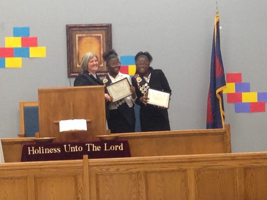 "Jackson Salvation Army Maj. Jayne May presents awards to two Commissioner Sunbeam award winners during ""Youth Sunday."""
