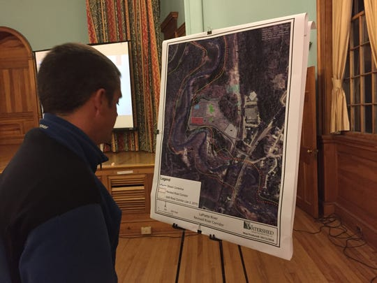 Community member looks at a water shed map of the LaPlatte River during public hearing regarding a storm water permit application for Vermont Rail at Shelburne Town Hall on Thursday, Oct. 13, 2016.