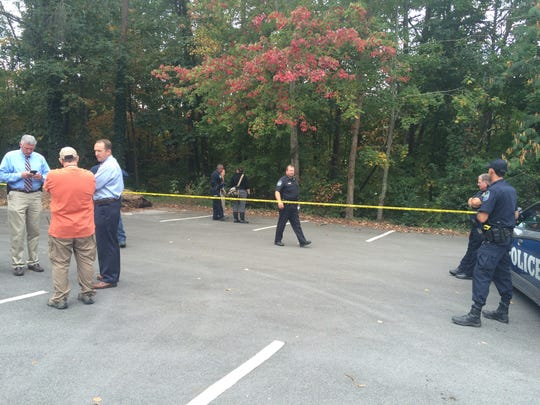 Knoxville police investigate the discovery of a body Monday, Oct. 17, 2016, behind the parking lot of a North Knoxville church.