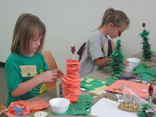 Shelby and Siobhan craft paper Christmas trees.