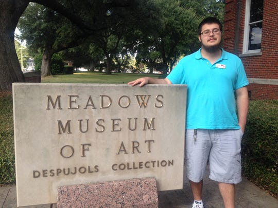 Meadows Museum student worker, Tyler Nale, researches