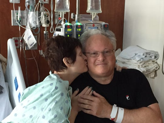 Renee Schulz-Stangl gives her brother, Brian Rasmussen, a kiss after he donates bone marrow for her transplant.