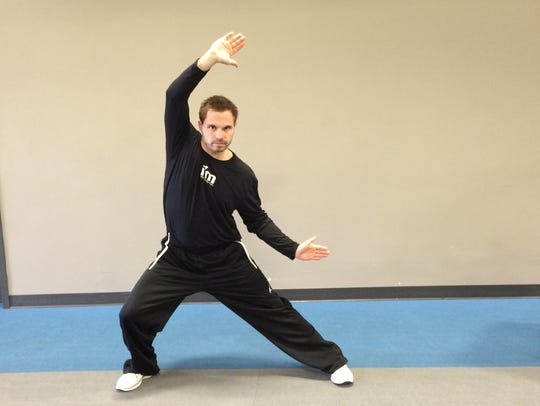 Joe Tofferi demonstrates lateral lunges, which can
