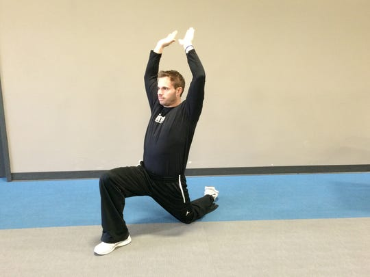 Joe Tofferi demonstrates forward lunges, which can