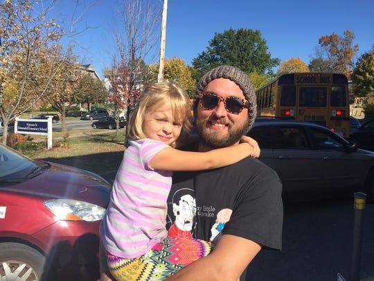 Matthew Costello and daughter stand outside the Edmunds