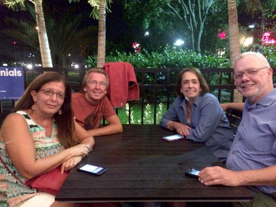 "From left, Marian Frane, Lyle Marshall, Angela Rall and John Rall, all of Cape Coral, join Lee County Young Democrats at debate watch party at Applebee's Restaurant in south Fort Myers.  John Rall said the two couples had dinner on Matlacha and came to the event so they could watch the debate with ""like-minded people."""
