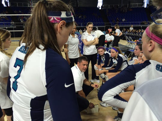Siegel coach Shawn Robinson talks to players during the TSSAA Class AAA State Volleyball Tournament Wednesday at MTSU.