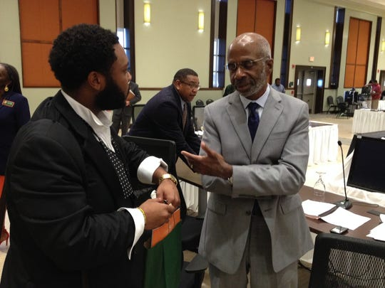 Interim FAMU President Larry Robinson, right, chats with FAMU SGA President and board of trustees member Jaylen Smith following Robinson's recent appointment.