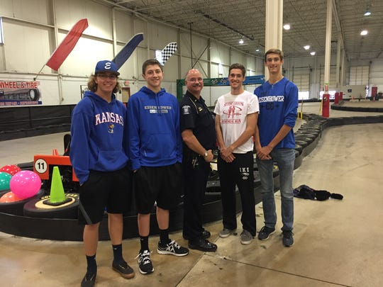 Eisenhower HS classmates (from left) Hunter McShane, Kameron Marnon, Evan Esper and Zachary Pickell with Sterling Heights Police Lt. Aaron Burgess at Kart2Kart.
