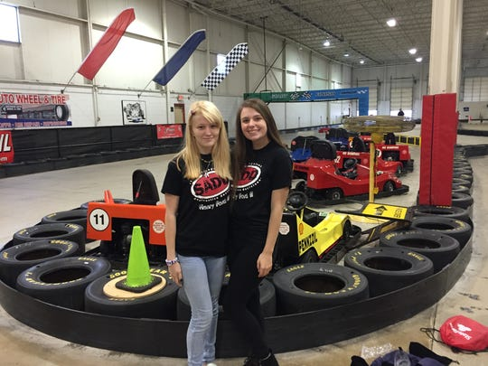 Henry Ford II HS friends Katie Hohenstern (left) and Kayla Agosta take a break during Kart2Kart program on Thursday.