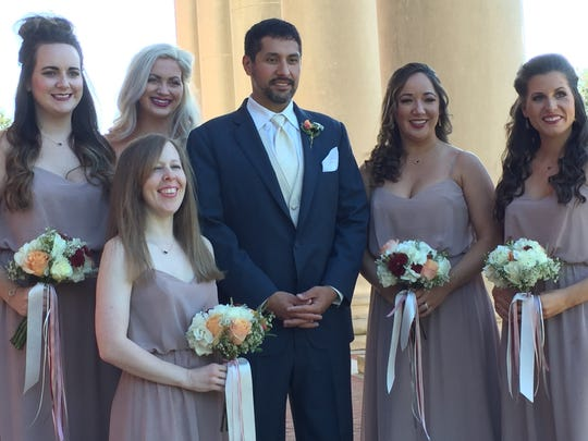 Groom James Patrick Ezernack with bridesmaids at his