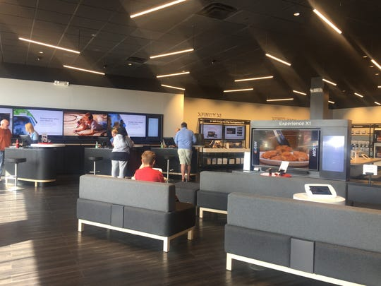 Comcast's Xfinity stores have an open floor plan with large seating areas and tech stations where customers can try out apps and other products.