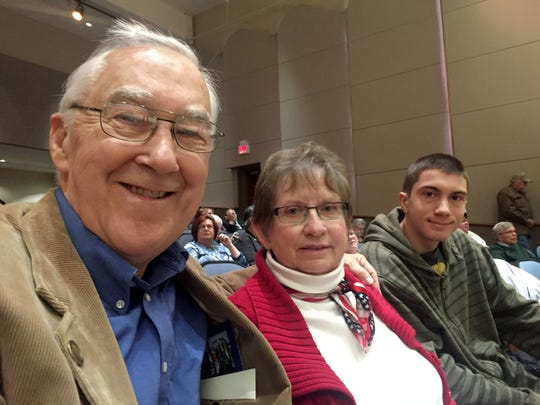 Vietnam War veteran Bruce Campbell, 69, of Holly attends the ceremony in Warren on Oct. 21, 2016 with his wife, Betty Campbell, and his grandson, Connor Campbell, 15, of White Lake.