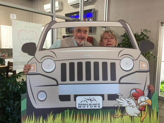 Mayor Tom Battin and Chamber of Commerce director Becky Brooks ham it up at Business After Hours Friday at Sierra Blanca Motors.